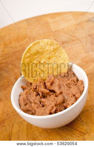 Corn Chip Buried In Refried Beans Dish Snack Appetizer