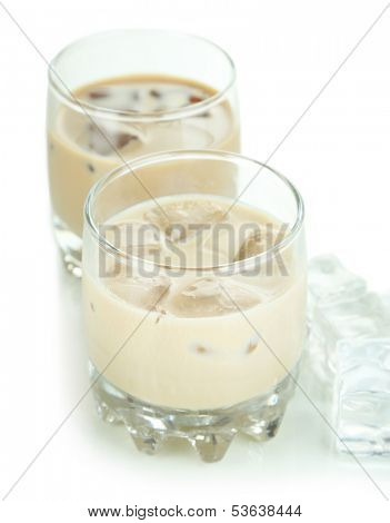 Baileys liqueur in glasses isolated on white