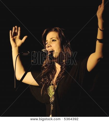 Nita Clapping Hands And Singing In Mic In Concert