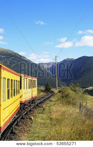 Little Yellow Train In The Pyrenees Mountains, France