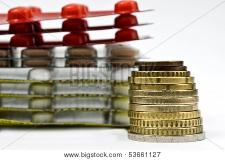 Stack Of Money And Medicines As Healthcare Concept