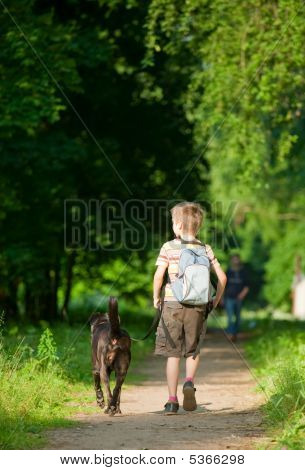 Kid With A Dog