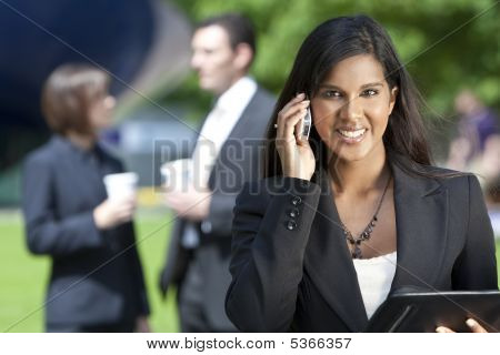 Young Asian Businesswoman On Her Cell Phone