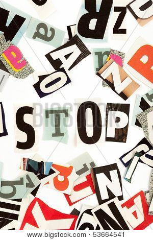 Stop inscription made with cut out letters