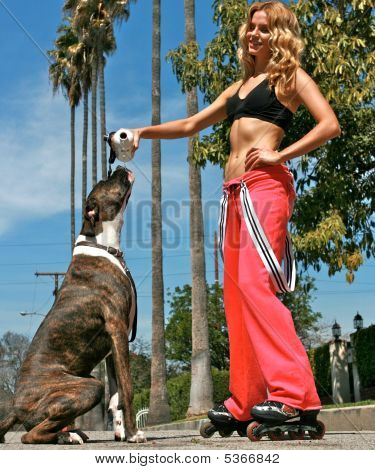 Attractive Blond Giving Her Dog Water