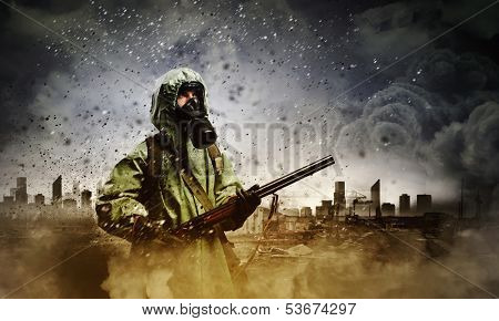 Image of stalker with gun. Ecology catastrophe