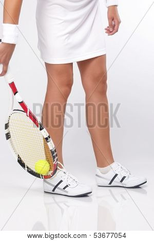 Closeup On The Legs Of Caucasian Female Tennis Sportswoman In Professional Outfit Grasping Tennis Ba