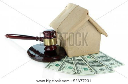 Gavel,model of house and money isolated on white