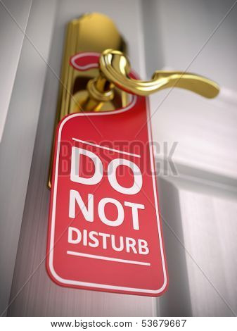 Do not disturb sign on hotel door handle