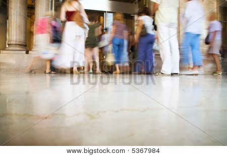 People Entering Into Modern Shop