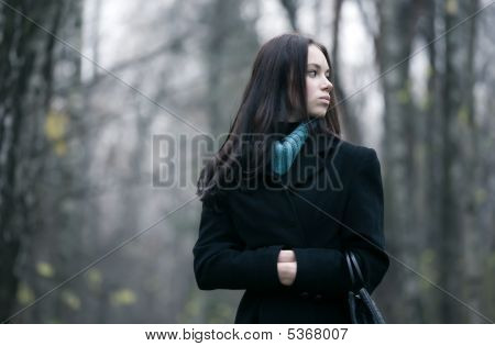Lonely Woman In A Forest