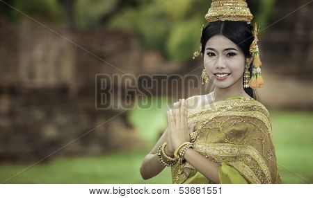 Woman Performing Typical Thai Dance With Thai Style Temple Background