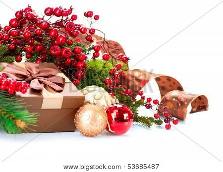 Christmas. Christmas Decoration and Gift Box Holiday Decorations Isolated on White Background. Christmas Scene with Ribbon, Holly Berry, Baubles and Present Box. Red, Brown and Gold Colors