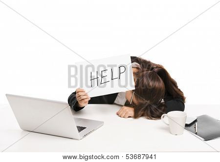Stressed business woman in the office holding a paper witl the word Help, isolated over a white background