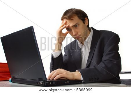 Closeup Stressed Young Man Works On Laptop