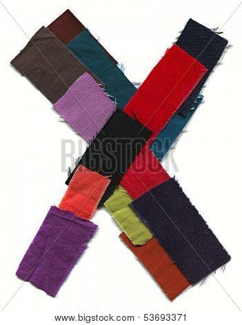 Letter X. Cotton texture.
