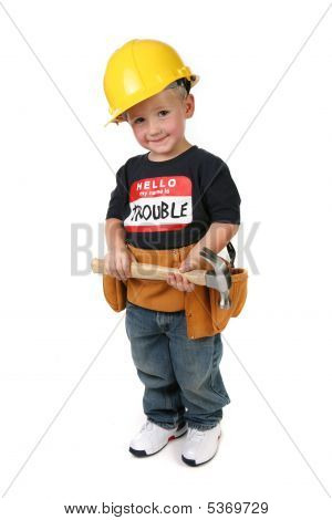 Boy Holding Hammer Wearing Toolbelt And Hard Hat