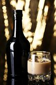 pic of bailey  - Baileys liqueur in bottle and glass on golden background - JPG