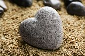 image of pumice stone  - Grey stone in shape of heart - JPG