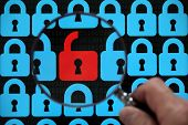 stock photo of hack  - Internet security concept open red padlock virus or threat of hacking - JPG