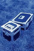 Silver Tin Box On A Green Lawn - tinted blue