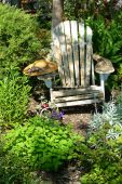 Weathered Chair And Hat In Picturesque Garden Scene poster