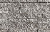 stock photo of brick block  - Seamless background photo texture of gray rough brick wall - JPG