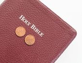 stock photo of tithe  - Holy Bible with money on top - JPG