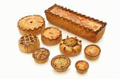 selection of traditional British pork pies on white