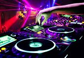 foto of disc jockey  - Dj mixes the track in nightclub at party - JPG