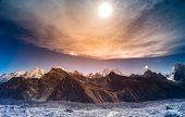 stock photo of snow clouds  - Himalaya scenic mountain landscape against the sunset sky - JPG