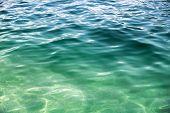 stock photo of refraction  - Coastal Adriatic sea water background photo texture - JPG
