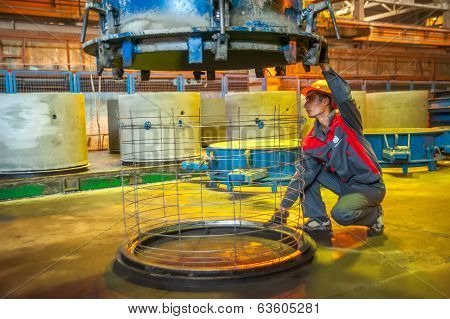 Worker controls process of making circle block