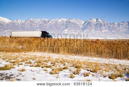 Semi Truck Speeding Down Utah Highway Winter Wasatch Mountains