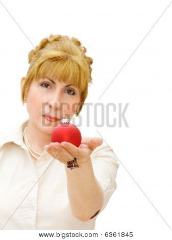 Merry Christmas! - woman gives red bauble