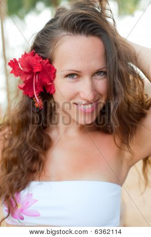 Alluring Woman With Red Flower