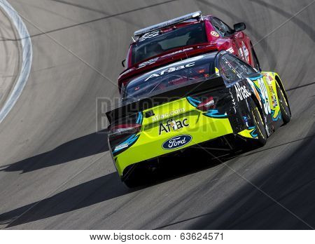 Las Vegas , NV - Mar 09, 2014:  Carl Edwards (99) battles for position during the Kobalt Tools 400 race at the Las Vegas Motor Speedway  in Las Vegas , NV.