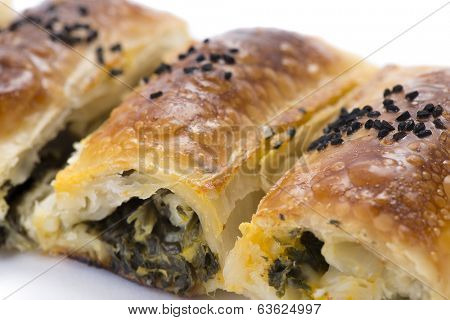 Turkish borek with spinach isolated on white background