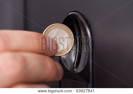 Human Hand Inserting Coin