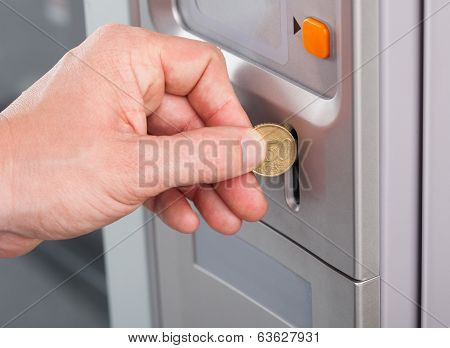 Human Hand Inserting Coin In Vending Machine