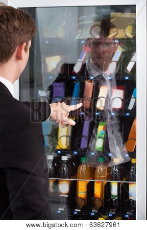 Man Pointing Towards Window Display