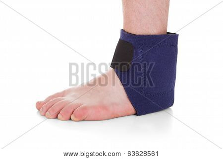 Close-up Of Man Wearing Brace On Foot