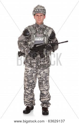 Portrait Of Solider Holding Rifle