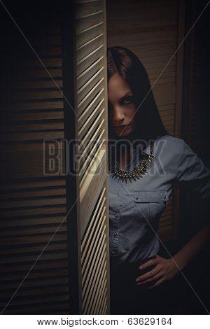 Emotion expression dark girl face next to door