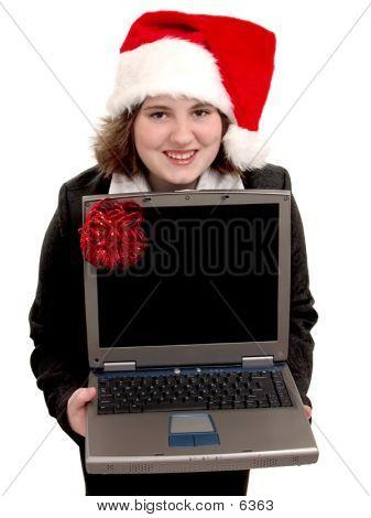 Teen W/Laptop y sombrero de Santa