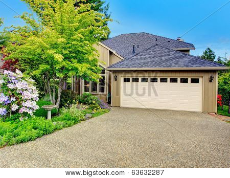 House Exterior. Garage And Driveway View