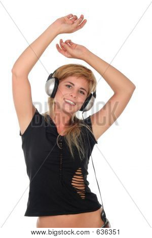 Young Woman Dancing To Music In Headphones