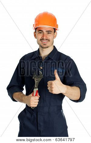 young worker standing with spanner isolated on white background