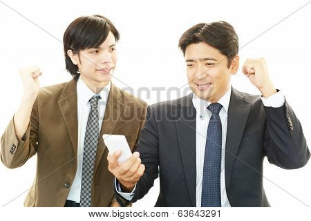 Happy men holding smart phone