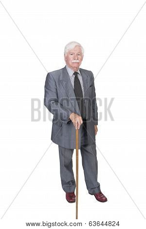 Old Man With Walking Stick In A Grey Suit